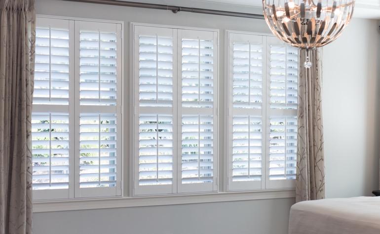 Plantation shutters charlotte sunburst shutters charlotte for Indoor wood shutters white