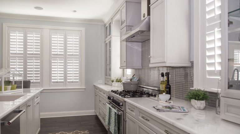 Polywood shutters in Charlotte kitchen with modern appliances.