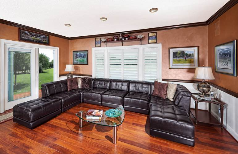 Charlotte basement with sliding doors and plantation shutters.