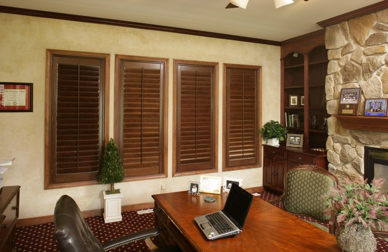 Wooden plantation shutters in a Charlotte home office