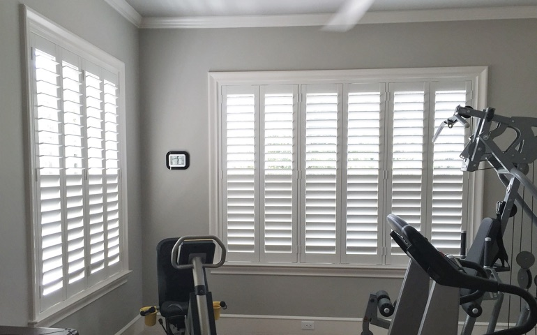 Charlotte exercise room with shuttered windows.