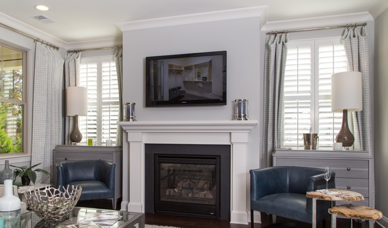 Charlotte fireplace with plantation shutters.