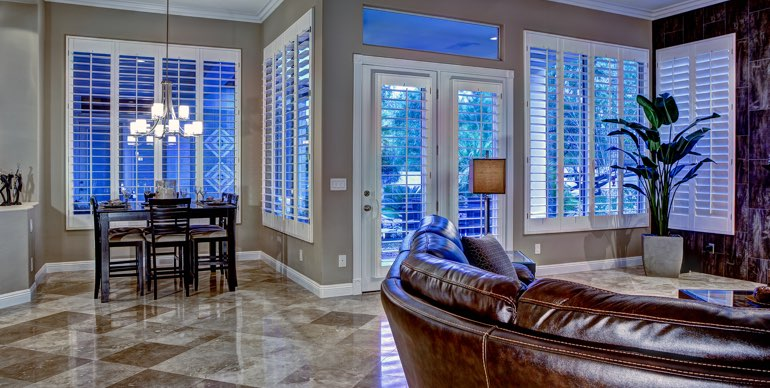 Charlotte great room with plantation shutters and modern lighting.