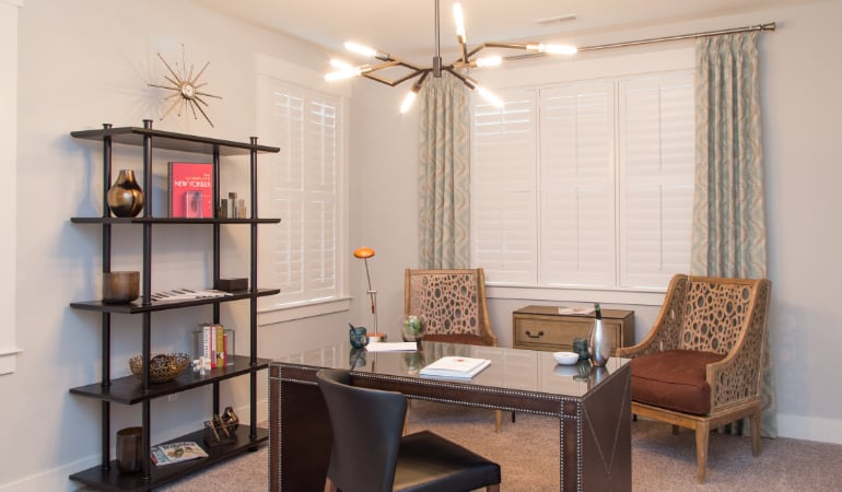 Charlotte home office with plantation shutters.