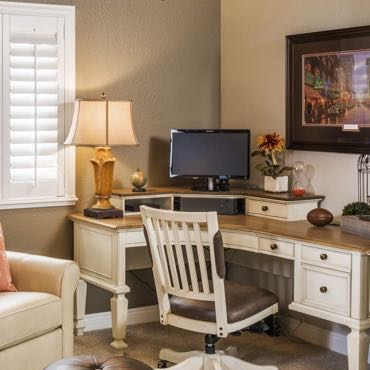 Charlotte home office plantation shutters.