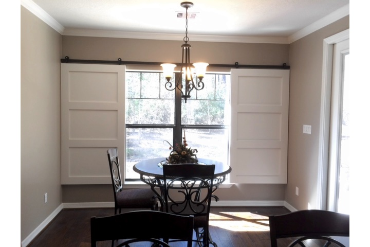 Charlotte dining room with white barn door shutters.
