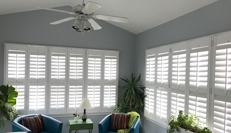 Charlotte sunroom with fan and shutters