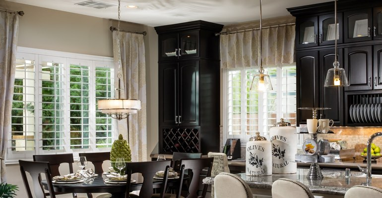 Charlotte kitchen dining room with plantation shutters.
