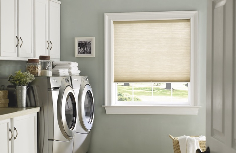 Charlotte laundry room with beige window shades.