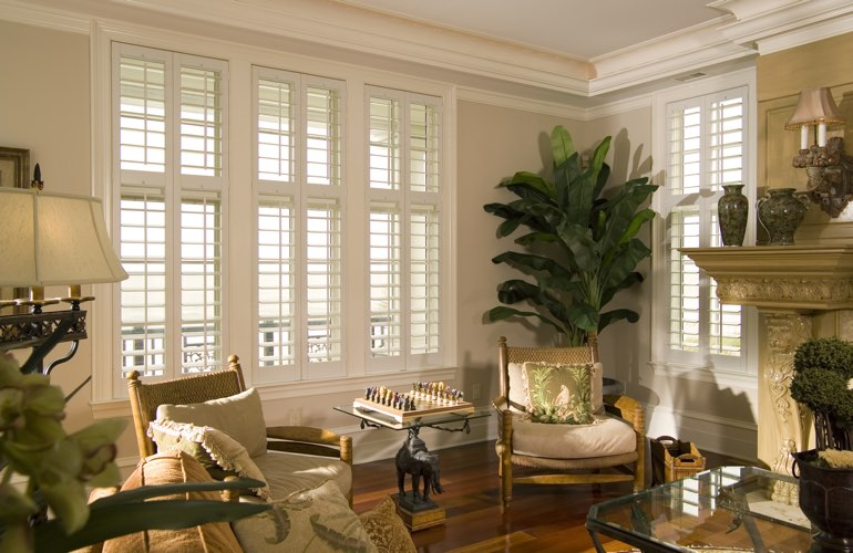 Living Room in Charlotte with white plantation shutters.