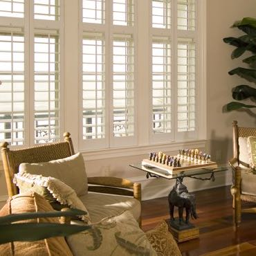 Charlotte living room polywood shutters.