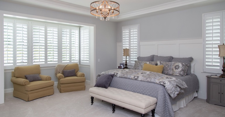 Interior shutters in Charlotte bedroom.