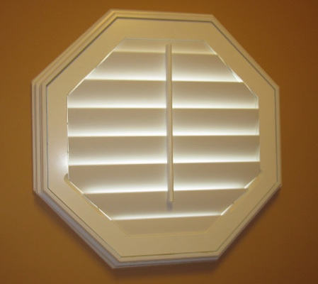 Charlotte octagon window with white shutter