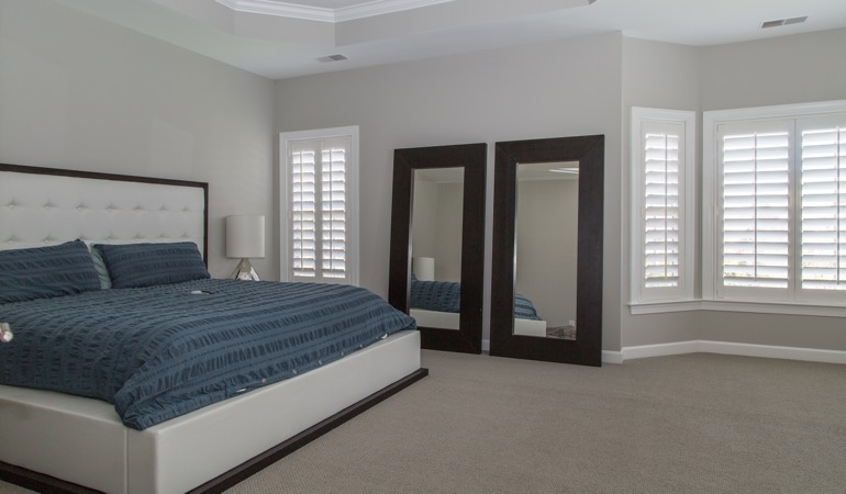 Polywood shutters in a minimalist bedroom in Charlotte.