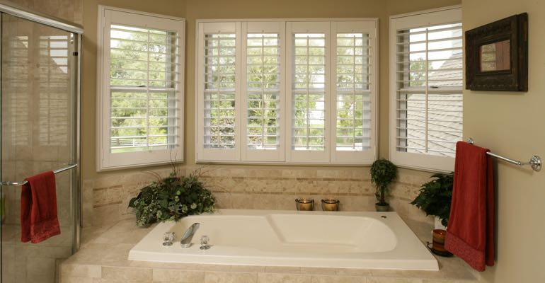 Plantation shutters in Charlotte bathroom.