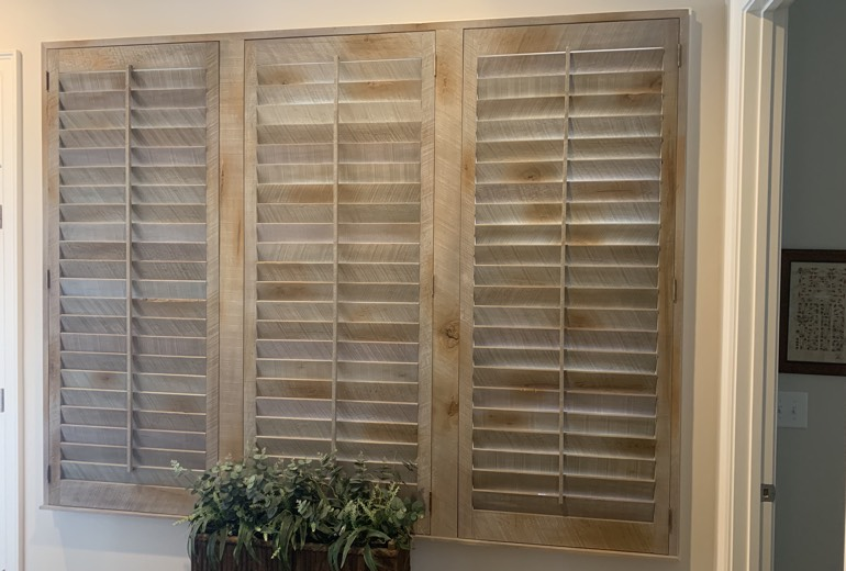 Closed reclaimed wood shutters in Charlotte