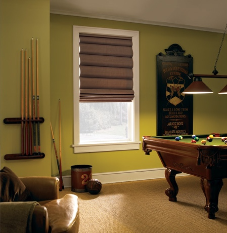 Roman shades in Charlotte pool room with green walls.