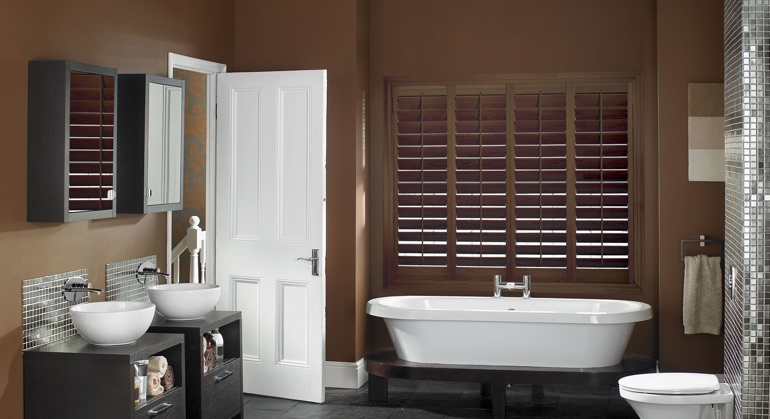 Stained wood shutter in Charlotte bathroom