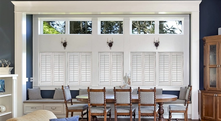 Charlotte dining room with white plantation shutters.
