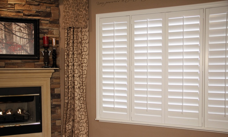 Charlotte Studio plantation shutters in family room.