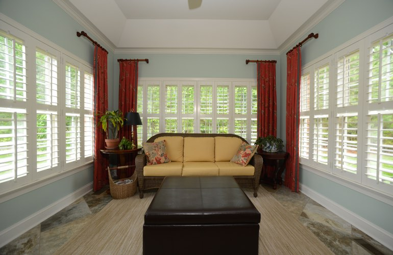 Charlotte sunroom with classic window shutters.