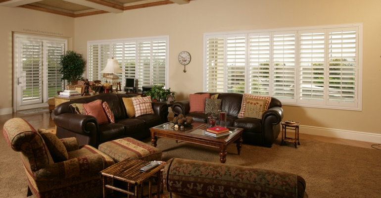 Charlotte sunroom with custom shutters.