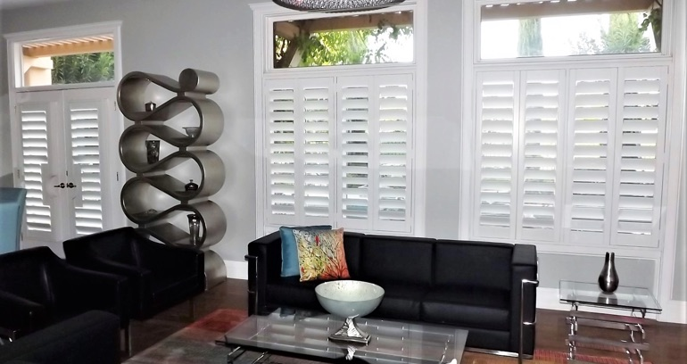 Charlotte DIY shutters in living room.