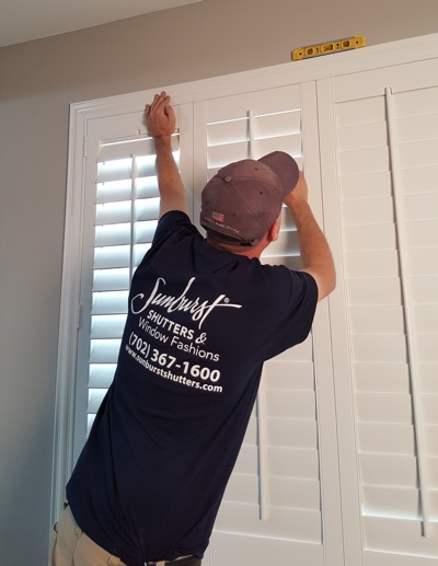 Shutter installation in Charlotte bedroom.