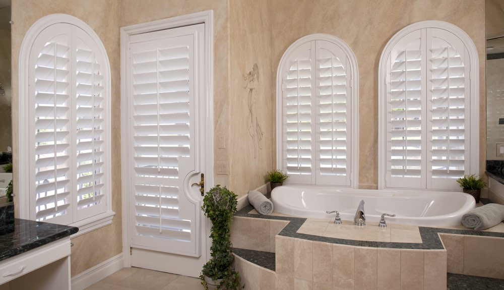 Arched Shutters In A Charlotte Bathroom
