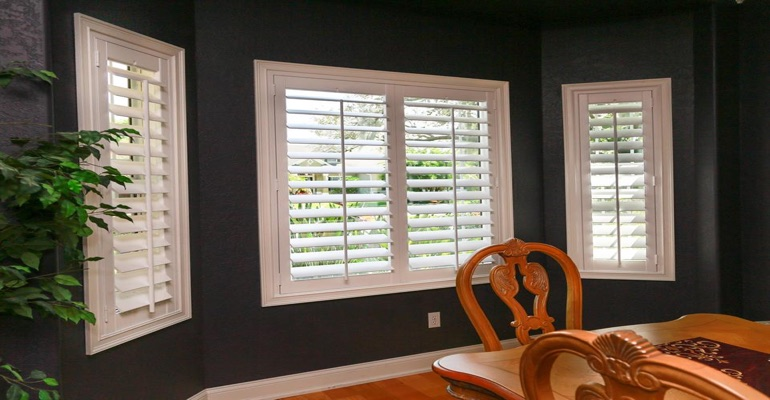 Crisp Polywood Shutters In Dark Green Dining Room