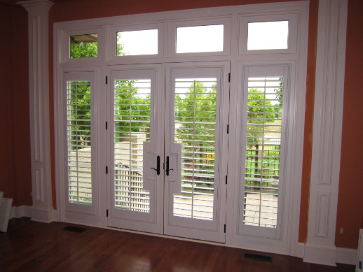 Charlotte patio door with sidelight shutters