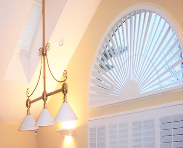 Charlotte arched eyebrow window with custom shutter