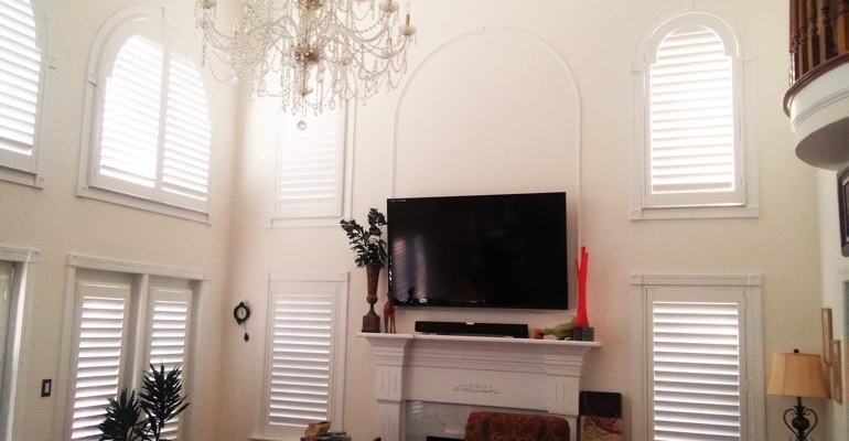 tall windows with shutters Charlotte tv room