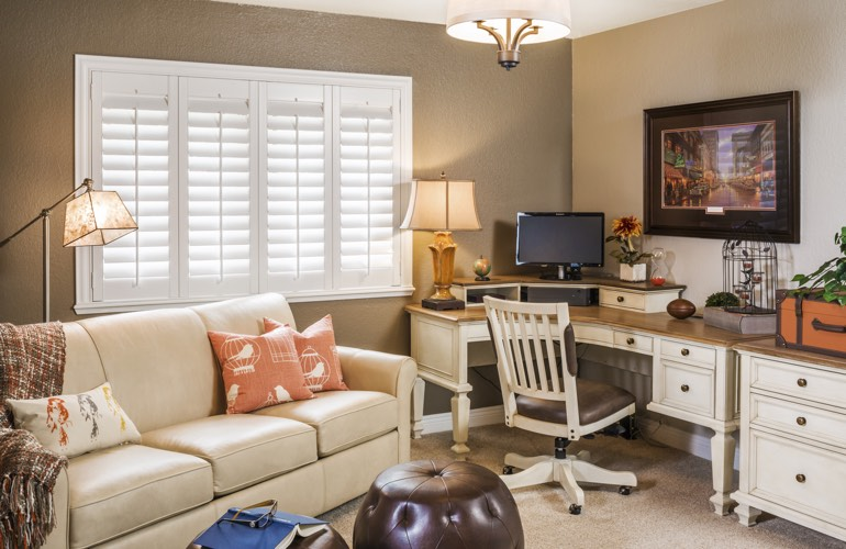 Charlotte home office with white window shutters.