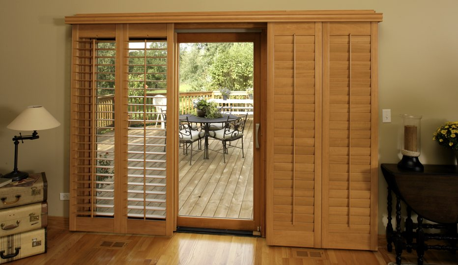 Wood bypass patio door shutters in Charlotte living room