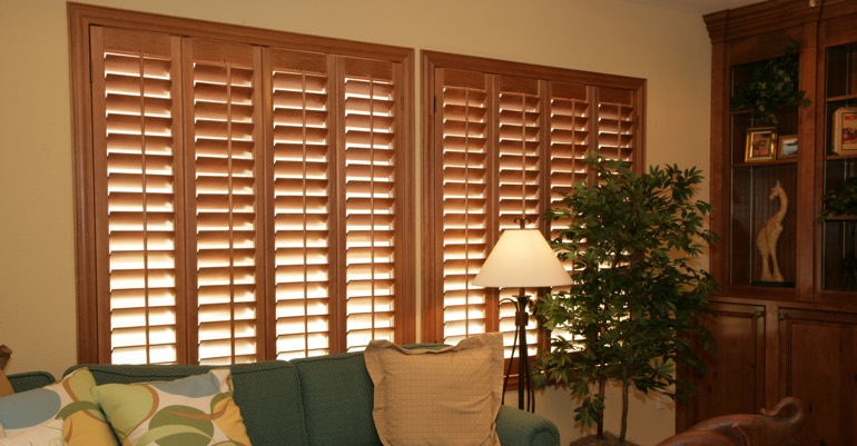 Natural wood shutters in Charlotte living room.