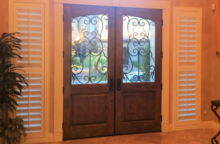 Sidelight window shutters in Charlotte foyer