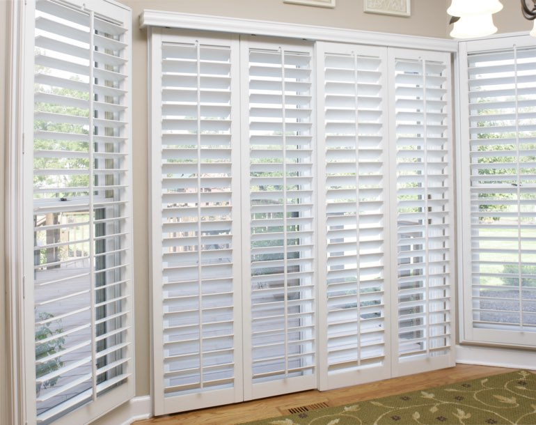 Sliding glass door with white shutters Charlotte
