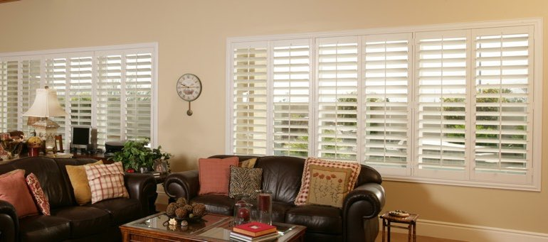 Wide window with plantation shutters in Charlotte living room